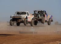 Apr 17, 2011; Surprise, AZ USA; LOORRS driver Carl Renezeder (17) leads Bryce Menzies (7) during round 4 at Speedworld Off Road Park. Mandatory Credit: Mark J. Rebilas-