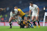 Ben Morgan of England is tackled by Kurtley Beale of Australia during Match 26 of the Rugby World Cup 2015 between England and Australia - 03/10/2015 - Twickenham Stadium, London<br /> Mandatory Credit: Rob Munro/Stewart Communications