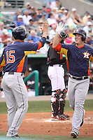 Houston Astros third baseman Matt Dominguez (30) is congratulated by Jason Castro (15) after hitting a home run against the Miami Marlins during a spring training game at the Roger Dean Complex in Jupiter, Florida on March 12, 2013. Houston defeated Miami 9-4. (Stacy Jo Grant/Four Seam Images)........