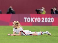 KASHIMA, JAPAN - JULY 27: Samantha Mewis #3 of the USWNT lies on the ground after being fouled during a game between Australia and USWNT at Ibaraki Kashima Stadium on July 27, 2021 in Kashima, Japan.