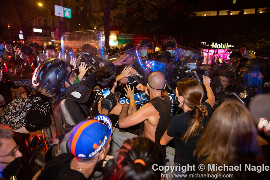 Protesters clash with NYPD officers during an anti-racism and anti-police brutality demonstrator on Delancey Street in New York, U.S., on Saturday, July 25, 2020. Photographer: Michael Nagle/Bloomberg