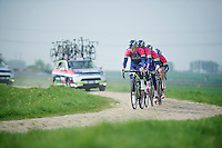 Team Lampre-Merida coming through sector 12: Pavé d'Orchies<br /> <br /> 2014 Paris-Roubaix reconnaissance