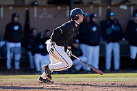Jack Gallagher of the University of South Carolina Upstate Spartans hits in a game against the University of Toledo Rockets on Saturday, February 20, 2021, at Cleveland S. Harley Park in Spartanburg, South Carolina. (Tom Priddy/Four Seam Images)