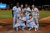 Bradenton Marauders (clockwise from bottom right) Francisco Acuna (3), Daniel Rivero (23), Wandi Montout (24), Ernny Ordonez (14), Oliver Mateo (43), and Endy Rodriguez (5) pose with the trophy after clinching the Low-A Southeast Championship Series with a sweep of the Tampa Tarpons on September 24, 2021 at George M. Steinbrenner Field in Tampa, Florida.  (Mike Janes/Four Seam Images)
