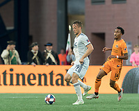 FOXBOROUGH, MA - JUNE 29: Antonio Mlinar Delamea #19 dribbles as Marlon Hairston #14 closes during a game between Houston Dynamo and New England Revolution at Gillette Stadium on June 29, 2019 in Foxborough, Massachusetts.