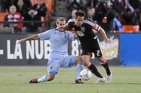 D.C. United midfielder Danny Cruz (2) gets tackle by Sporting Kansas City midfielder Graham Zusi (8) Sporting Kansas City defeated D.C. United  1-0 at RFK Stadium, Saturday March 10, 2012.