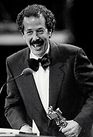 1987 FILE PHOTO - ARCHIVES -<br /> <br /> Quebec director Denys Arcand accepts a Genie award in Toronto last night for his movie, The Decline Of The American Empire. The film won eight Genies - including best picture and, in special honor of Arcand, best director and screenplay.<br /> <br /> PHOTO :  Jeff Goode - Toronto Star Archives - AQP