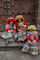 Peru, Cusco.  Young Quechua Women.  They wear traditional dress hoping to be photographed for tips.