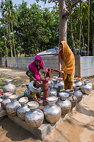 Bangladesh, Teknaf, Cox's Bazar. Leda Rohingya Refugee Camp. The Rohingya, a Muslim ethnic group  denied citizenship in Burma/Myanmar have escaped persecution from Burmese militants in their country. There are up to 500,000 refugees and migrants living in makeshift camps in Teknaf, Cox's Bazar. A long wait at the pump for the water to turn on so it can be collected.