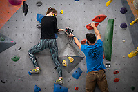 Tuva Bygrave makes her way up a wall with help from Alaska Rock Gym operations manager and UAA recreation course instructor Eric Wickenheiser as he teaches Beginning Indoor Sport Climbing (PER A148) at the Alaska Rock Gym in Anchorage.