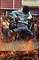 Turkey 2005 Nowruz in the street of Dogubayazit, a young boy jumping over the fire   Turquie 2005  Célébration de Nowruz à Dogubayazit, un jeune homme saute au'dessus du feu allumé dans la rue
