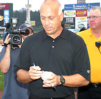 August 29, 2003:  Cal Ripken Jr. signs autographs as he's inducted into the Rochester Red Wings Hall of Fame before an International League game at Frontier Field in Rochester, NY.  Photo by:  Mike Janes/Four Seam Images