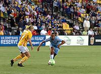 Sky Blue FC midfielder Rosana contests a ball with Atlanta Beat defender Katie Larkin.