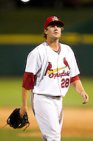 Brett Zawacki (28) of the Springfield Cardinals walks to the dugout during a game against the Tulsa Drillers at Hammons Field on July 19, 2011 in Springfield, Missouri. Tulsa defeated Springfield 17-11. (David Welker / Four Seam Images)