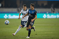 SAN JOSE, CA - OCTOBER 07: Cade Cowell #44 of the San Jose Earthquakes and Ranko Veselinovic #4 of the Vancouver Whitecaps battle for the ball during a game between Vancouver Whitecaps and San Jose Earthquakes at Eathquakes Stadium on October 07, 2020 in San Jose, California.