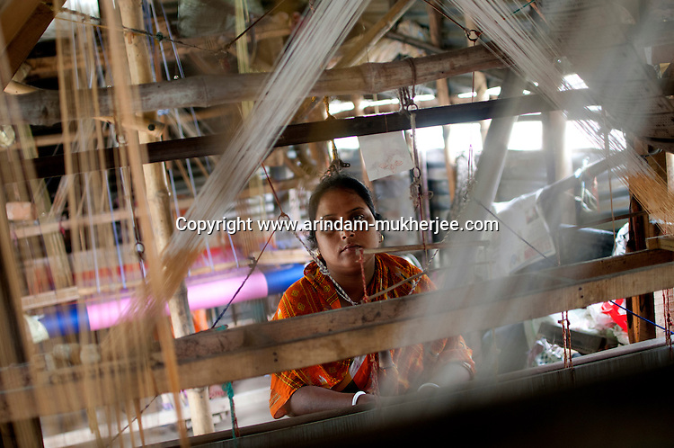 Nomita Biswas (32), is a weaver of fine handloom sarees, She expanded her business by taking micro credit from Bandhan. She earns about 400 usd/ month. Shantipur, West Bengal, India. Arindam Mukherjee