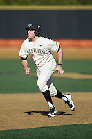 Will Craig (22) of the Wake Forest Demon Deacons takes off for third base during the game against the Richmond Spiders at David F. Couch Ballpark on March 6, 2016 in Winston-Salem, North Carolina.  The Demon Deacons defeated the Spiders 17-4.  (Brian Westerholt/Four Seam Images)