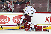 Chris Calnan (BC - 11), Sean Little (Wisconsin - 18) - The Boston College Eagles defeated the visiting University of Wisconsin Badgers 9-2 on Friday, October 18, 2013, at Kelley Rink in Conte Forum in Chestnut Hill, Massachusetts.