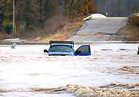Marc Hayot/Siloam Sunday. A man driving up Fisher Ford road stalled out near Siloam Springs Kayak Park located at 19253 Fisher Ford Rd. The vehicle was almost completely submerged by the flood waters.