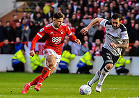 Nottingham Forest's midfielder Matty Cash (14) runs past Derby County's midfielder Bradley Johnson (15) during the Sky Bet Championship match between Nottingham Forest and Derby County at the City Ground, Nottingham, England on 10 March 2018. Photo by Stephen Buckley / PRiME Media Images.