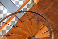 BNPS.co.uk (01202 558833)<br /> Pic: KnightFrank/BNPS<br /> <br /> Pictured: Spiral staircase.<br /> <br /> An impressive family home built in an 'industrial scale' oast house with multiple circular rooms is on the market for £1.6m.<br /> <br /> The property is one half of a massive former six roundel oast house that has been expanded and renovated by the current owners.<br /> <br /> Estate agents Knight Frank say the roundels are far larger than normally seen in most oast houses, which means the property has quirky character while also being a practical family home.<br /> <br /> This six-bedroom house is in the picturesque Kent countryside, but just 1.5 miles from the village of Hadlow and ten minutes' drive from the bigger town of Tonbridge.