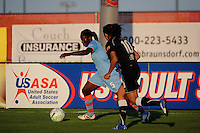 Anita Asante (5) of Sky Blue FC and Marta (10) of the Western New York Flash. The Western New York Flash defeated Sky Blue FC 4-1 during a Women's Professional Soccer (WPS) match at Yurcak Field in Piscataway, NJ, on July 30, 2011.