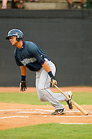 Jorge Agudelo #7 of the Pulaski Mariners follows through on his swing against the Bristol White Sox at Boyce Cox Field August 28, 2010, in Bristol, Tennessee.  Photo by Brian Westerholt / Four Seam Images