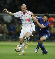 Italian midfielder (8) Gennaro Gattuso fights for the ball with French midfielder (10) Zinedine Zidane.  Italy defeated France on penalty kicks after leaving the score tied, 1-1, in regulation time in the FIFA World Cup final match at Olympic Stadium in Berlin, Germany, July 9, 2006.