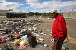 A Mexican garbage collector walks past a dump in Oaxaca city, in southern state of Oaxaca, December 4, 2006. Photo by Heriberto Rodriguez