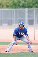 Zach Cone #15 of the Texas Rangers during a Minor League Spring Training Game against the Kansas City Royals at the Kansas City Royals Spring Training Complex on March 20, 2014 in Surprise, Arizona. (Larry Goren/Four Seam Images)