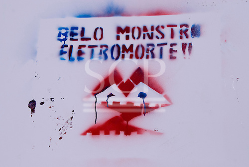 """Altamira, Brazil. Frontier town on the Xingu river. """"Belo Monstro, Electromorte"""" graffitti, against the dams, 2008. Encontro Xingu protest meeting about the proposed Belo Monte hydroeletric dam and other dams on the Xingu river and its tributaries."""