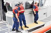 Crew of the US Coast Guard Response Boat-Medium (RB-M) 45610 helping a stranded boater