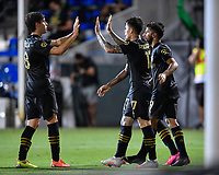 LAKE BUENA VISTA, FL - JULY 18: Francisco Ginella #8 of LAFC and teammate Brian Rodríguez #17 celebrate a goal by Diego Rossi #9 of LAFC during a game between Los Angeles Galaxy and Los Angeles FC at ESPN Wide World of Sports on July 18, 2020 in Lake Buena Vista, Florida.