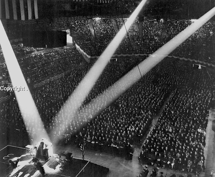 To prove that every working man in America is heart and soul behind this country's all-out war effort, the Wholesale and Warehouse Workers Union in New York City met for this imposing Victory rally in the city's famous Madison Square Garden.  (OWI)<br /> Exact Date Shot unknown<br /> NARA FILE #:  208-AMC-3D-9<br /> WAR & CONFLICT #:  771