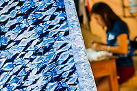 An indigo-dyed fabric is seen hung in front of a seamstress working in an artisanal clothing workshop in Santiago Nonualco, El Salvador, 6 April 2018. For centuries, indigo, a natural deep blue dye extracted from the leaves of tropical plants, has been known to the native indigenous inhabitants of Central America. Nowadays, a growing demand for handmade, nature-based products has has permitted the emergence of various clothing workshops and cooperatives. Employing traditional design techniques and inspired by the ancient Mayan artists, they produce fashion collections, clothing accessories or decorative items on a sustainable, small scale basis.