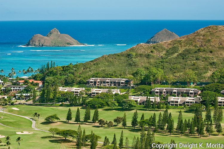 Bluestone Condominiums - Dramatic view of the possibilities of life in the Bluestone community. The Mokulua Islands stand off the world-class beach at Lanikai, where many water sports are available. The Mid-Pacific Country Club in the foreground is a beautiful golf course with grand views of the Koolau range as you play.  Two of the tennis courts at Bluestone are pictured in the middle right.