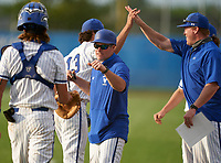 Lakeland Christian Vikings head coach Matt Diaz fist bumps catcher Brody Donay (4) as pitching coach Michael Byrd high fives pitcher Mack Estrada (13) during the IMG National Classic on March 29, 2021 at IMG Academy in Bradenton, Florida.  (Mike Janes/Four Seam Images)