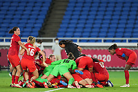 YOKOHAMA, JAPAN - AUGUST 6: Team Canada celebrates their victory of the gold medal match after a penatly kicks after a game between Canada and Sweden at International Stadium Yokohama on August 6, 2021 in Yokohama, Japan.