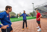 Moscow, Russia, 14 th July, 2016, Tennis,  Davis Cup Russia-Netherlands, Dutch team practise, Wesley Koolhof (L) and Tim van Rijthoven  warming up with fysio Edwin Visser (M)<br /> Photo: Henk Koster/tennisimages.com