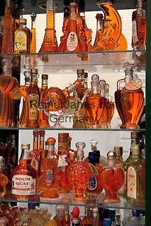 Greece, Corfu, Corfu-Town (Kerkyra): Kumquat Liqueur on display in tourist shop