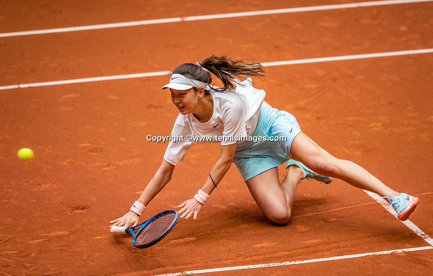 Den Bosch, The Netherlands, April 16, 2021,    Maaspoort, Billy Jean King Cup  Netherlands -  China , seccond day seccond match:   Xinyu Wang (CHN) makes a spectacular fall.<br /> Photo: Tennisimages/Henk Koster