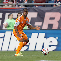 Houston Dynamo defender Corey Ashe (26) looks to pass. In a Major League Soccer (MLS) match, the New England Revolution (blue/white) defeated Houston Dynamo (orange), 2-0, at Gillette Stadium on April 12, 2014.