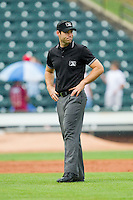 Umpire Morgan Day handles the calls on the bases during the Carolina League game between the Frederick Keys and the Winston-Salem Dash at BB&T Ballpark on July 21, 2013 in Winston-Salem, North Carolina.  The Dash defeated the Keys 3-2.  (Brian Westerholt/Four Seam Images)