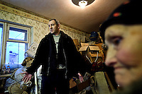 Nina Merzlikina, 75, and Sergei Kostenko, 45, with their packed possessions awaiting baliffs at their apartment in Vor Shor. Established beyond the Arctic Circle, where temperatures in winter drop to -50, most of its population left after the closure of its Soviet-era coal mine. Those who remain are being evicted by the regional authorities who want to save money by shutting off supplies of gas and electricity. Russia's far north is slowly declining. Every year thousands of people from its towns and cities flee south. The system of subsidies that propped up Siberia and the Arctic in Soviet times has crumbled. Now there is no advantage to living in the far north, salaries are no higher than in central Russia and prices for goods are higher. /Felix Features