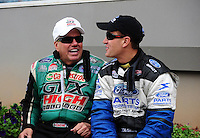 Sept. 18, 2011; Concord, NC, USA: NHRA funny car driver John Force (left) talks with Bob Tasca III during the O'Reilly Auto Parts Nationals at zMax Dragway. Mandatory Credit: Mark J. Rebilas-