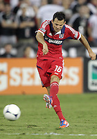 WASHINGTON, DC. - AUGUST 22, 2012:   Marco Pappa (16) of the Chicago Fire fires in a shot during an MLS match against DC United at RFK Stadium, in Washington DC,  on August 22. United won 4-2.