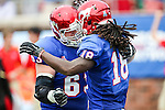 Southern Methodist Mustangs wide receiver Darius Joseph (18) and Southern Methodist Mustangs offensive linesman Evan Brown (63) in action during the game between the TCU Horned Frogs and the SMU Mustangs at the Gerald J. Ford Stadium in Fort Worth, Texas.  TCU leads SMU 28 to 0 at half.
