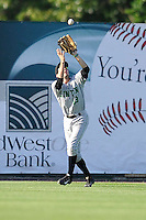 Aaron Barbosa #13 of the Clinton LumberKings catches a fly ball against the Burlington Bees at Community Field  on July 3, 2014 in Burlington, Iowa. The LumberKings defeated the Bees 6-5.   (Dennis Hubbard/Four Seam Images)