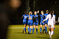 Seattle, WA - Thursday, March, 08, 2018: Seattle Reign FC celebrate during a preseason match between the Seattle Reign FC and University of Washington at Husky Soccer Stadium.