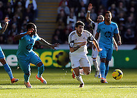 Wednesday, 19 January 2014<br /> Pictured: Alejandro Pozuelo of Swansea (C) against Danny Rose of Tottenham (L).<br /> Re: Barclay's Premier League, Swansea City FC v Tottenham Hotspur at the Liberty Stadium, south Wales.